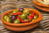 Tapas, marinated olives with red peppers