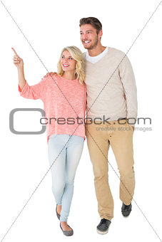 Attractive couple smiling and walking