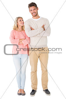 Attractive couple smiling with arms crossed