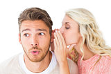 Attractive blonde whispering secret to boyfriend
