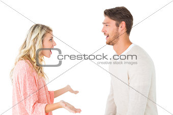 Attractive couple talking about something shocking