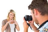 Man taking photo of his pretty girlfriend