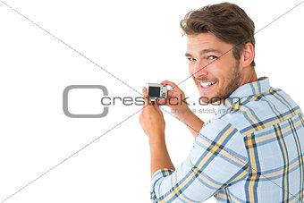 Man taking photo and smiling at camera