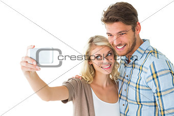 Attractive couple taking a selfie together