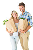 Attractive couple holding their grocery bags