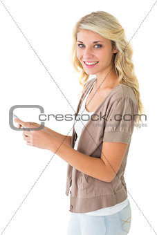 Attractive blonde using her smartphone