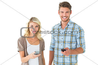 Attractive couple using their smartphones
