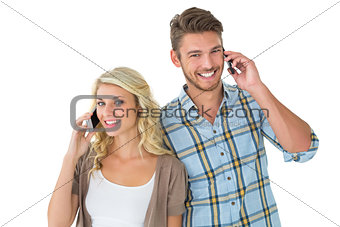 Attractive couple talking on their smartphones