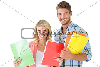 Attractive student couple smiling at camera