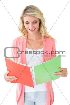 Attractive student reading from notepad