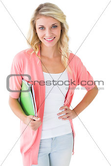Attractive student smiling at camera