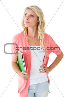 Attractive student holding notepads and thinking