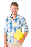 Handsome student holding notepad smiling at camera