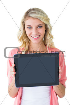 Handsome young man showing his tablet pc