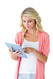 Pretty young blonde using her tablet pc