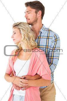 Attractive young couple embracing and smiling