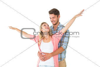Attractive young couple smiling and embracing