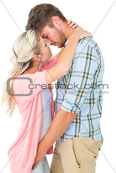 Attractive young couple about to kiss