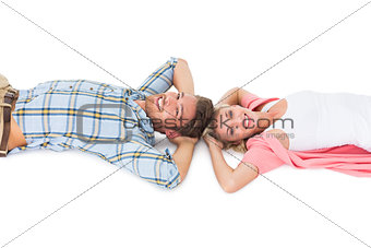 Attractive young couple lying smiling at camera
