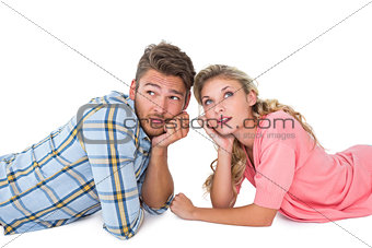 Attractive young couple lying and thinking