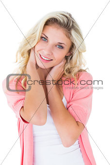 Pretty young blonde smiling at camera