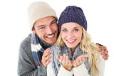 Attractive couple in winter fashion smiling at camera