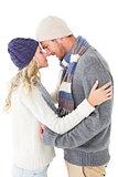 Attractive couple in winter fashion hugging