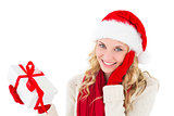 Festive blonde smiling at camera holding present
