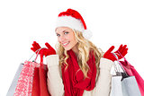 Festive blonde holding shopping bags