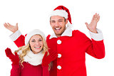 Festive couple smiling with arms raised