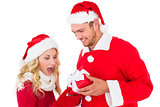 Festive young couple exchanging presents