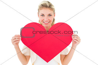 Attractive young blonde showing red heart