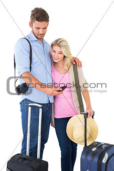 Attractive young couple ready to go on vacation