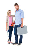 Young couple holding diy tools