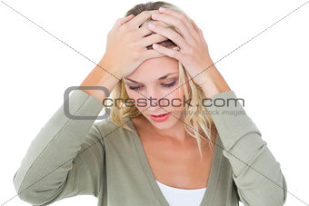 Confused young blonde with hands on head
