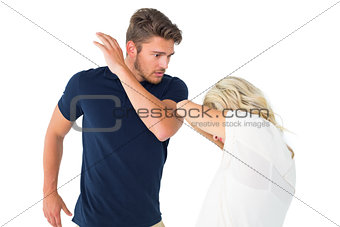 Angry man about to hit his girlfriend