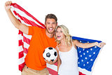 Excited football fan couple holding usa flag