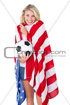 Pretty blonde football fan wearing usa flag