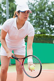 Focused tennis player ready to serve