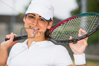 Pretty tennis player smiling at camera