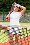 Pretty tennis player wiping her brow