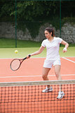 Pretty tennis player hitting ball