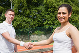 Tennis opponents shaking hands before match