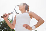 Pretty tennis player holding racket