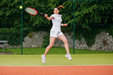Pretty tennis player about to hit ball