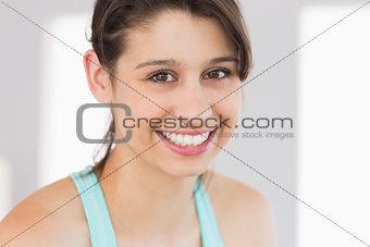 Fit brunette smiling at camera