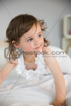 Close up of thoughtful girl looking away on bed
