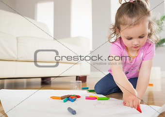 Little girl drawing in living room