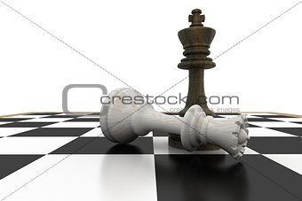 Black king standing over fallen white queen