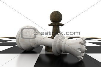 Black pawn standing over fallen white queen